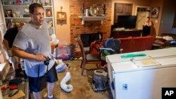 Raymond Lieteau takes photos his flood-damaged home in Baton Rouge, Louisiana, Aug. 16, 2016. Lieteau had more than five feet of water in his home.
