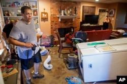 Raymond Lieteau takes photos his flood-damaged home in Baton Rouge, Louisiana, Aug. 16, 2016. Lieteau had more than five feet of water in his home.