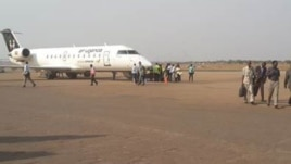 Passengers disembark at Juba International Airport, which is to undergo an overhaul funded by China's Export and Import Bank.