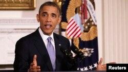 Presiden AS Barack Obama memberikan komentar mengenai pengesahan UU Anggaran di Gedung Putih hari Kamis (17/10).