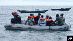 FILE - Cameroonian coast guardsmen and marines are seen in a rescue boat near the port town of Kribi, Cameroon. Thirty-two people, most of them Cameroonian soldiers, remain unaccounted for after their ship sank off the coast of the Bakassi Peninsula over a week ago.