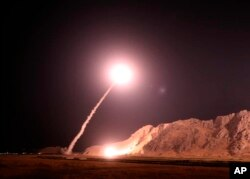 FILE - In this photo released on Oct. 1, 2018, by the Iranian Revolutionary Guard, a missile is fired from city of Kermanshah in western Iran targeting the Islamic State group in Syria.