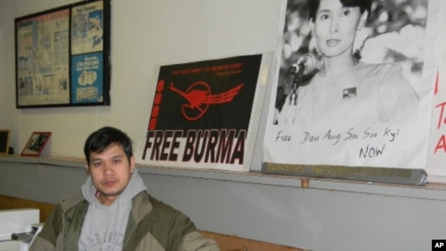 Zah Win in his Buffalo, New York, laundromat where the walls are covered with posters denouncing Burma's military junta.