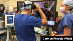 Stanford Director of Neurosurgery Dr. Gary Steinberg joins Malie Collins for a final refresher of the location of the aneurysm before Steinberg begins the surgery. Collins is the program manager of the Stanford Neurological Simulation & Virtual Reality Center.