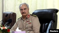 FILE - Libya's eastern-based commander Khalifa Haftar attends a security conference, in Benghazi, Libya, Oct. 14, 2017.