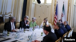 FILE - U.S. Secretary of State John Kerry (2nd R) meets with the Iranian delegation including Iranian Foreign Minister Mohammad Javad Zarif at a hotel where the Iran nuclear talks meetings are being held in Vienna, Austria, July 2, 2015.