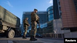Belgian soldiers patrol outside the European Commission headquarters in central Brussels Jan. 17, 2015.