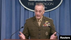 FILE - U.S. Joint Chiefs of Staff Chairman General Joseph Dunford speaks to the media at the Pentagon.