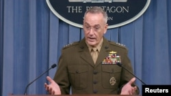 FILE - U.S. Joint Chiefs of Staff Chairman General Joseph Dunford is seen in a frame grab from U.S. Department of Defense video as he speaks to the media about the deaths of four U.S. Army special operations forces soldiers in Niger during a news conference about the attack at the Pentagon in Washington, U.S., Oct. 23, 2017.