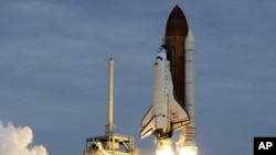 The space shuttle Atlantis lifts off from the Kennedy Space Center, July 8, 2011, in Cape Canaveral, Florida