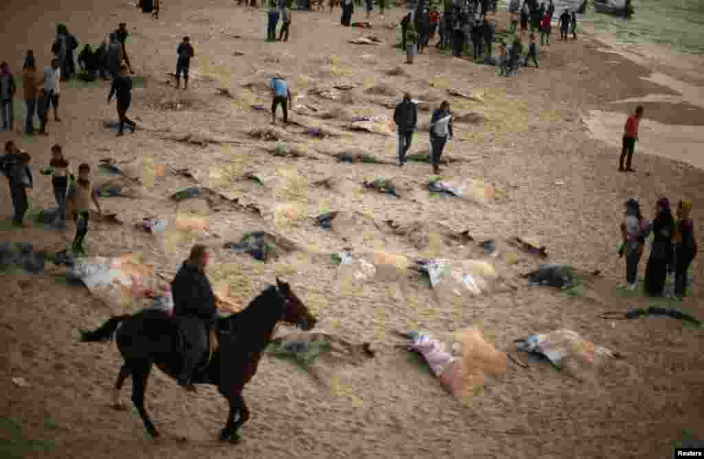 Palestinians look at Devil Rays on a beach in Gaza City.