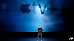Apple CEO Tim Cook speaks at the Steve Jobs Theater during an event to announce new products Monday, March 25, 2019, in Cupertino, Calif. (AP Photo/Tony Avelar)