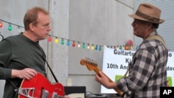 Mike Hardwick and Jon Dee Graham perform at 2010 SXSW festival in Austin, Texas