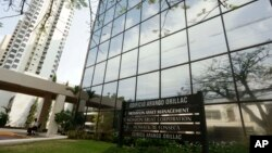 "FILE - A marquee of the Arango Orillac Building lists the Mossack Fonseca law firm in Panama City, April 3, 2016. Four men have been charged in what prosecutors described as an ""intercontinental money laundering scheme'' involving the global law firm."
