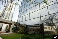 A marquee of the Arango Orillac Building lists the Mossack Fonseca law firm in Panama City, April 3, 2016.Germany's Sueddeutsche Zeitung newspaper obtained a vast trove of documents in 2016 detailing the offshore financial dealings of the rich and famous.