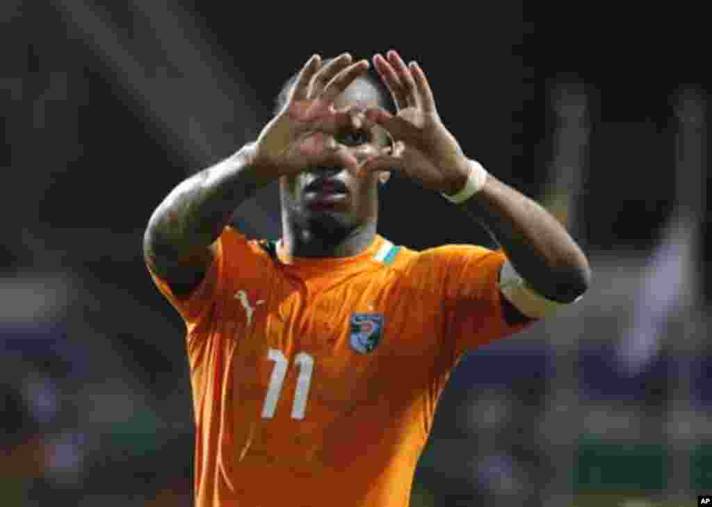 Ivory Coast's Didier Drogba celebrates after they won their African Nations Cup semi-final soccer match against Mali at the Stade De L'Amitie Stadium in Gabon's capital Libreville February 8, 2012.