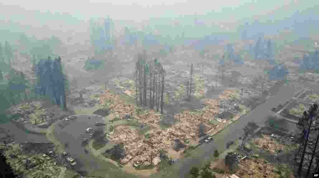 This aerial image shows a neighborhood that was destroyed by a wildfire in Santa Rosa, Calif., Oct. 10, 2017. Newly homeless residents of California wine country took stock of their shattered lives Tuesday.