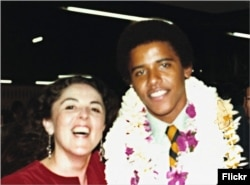 Barack Obama with his mother at his high school graduation