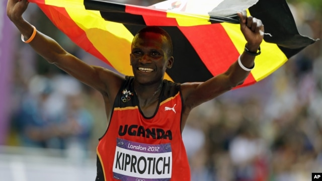 Uganda's Stephen Kiprotich celebrates after crossing the finish line to win gold in the men's marathon at the 2012 Summer Olympics, Aug. 12, 2012, London.