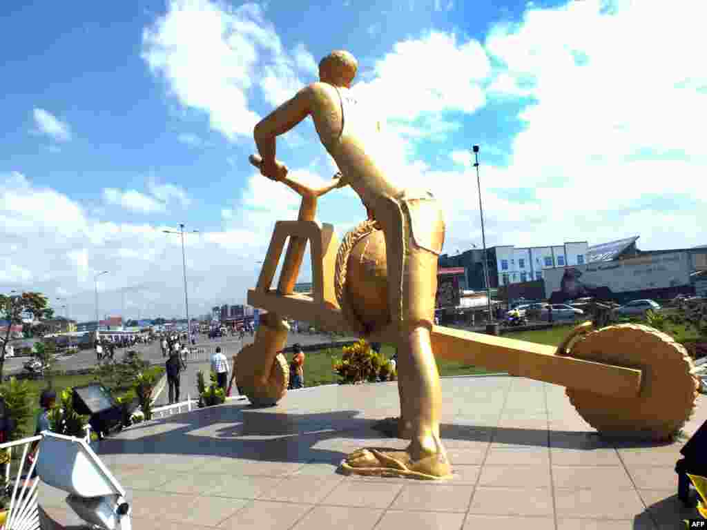 A sculpture of a man riding a tshukudu, wooden scooters used to transport goods in the eastern Democratic Republic of Congo city of Goma.