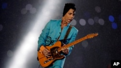 FILE - Prince performs during the halftime show at Super Bowl XLI at Dolphin Stadium in Miami, Feb. 4, 2007.