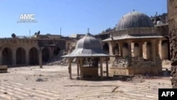Unverified image from Youtube video allegedly showing rubble of minaret (background) of Aleppo's ancient Umayyad mosque