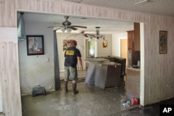 Dwight Chandler walks through his devastated home in Highlands, Texas, Aug. 31, 2017. Chandler, 62, said he worried that Harvey's floodwaters had washed in pollution from a U.S. EPA Superfund site a couple blocks from his home. The Highlands Acid Pit site near Chandler's home was filled in the 1950s with toxic sludge and sulfuric acid from oil and gas operations.