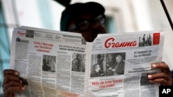FILE - A man reads the official newspaper of the Central Committee of the Cuban Communist Party, Granma, in old Havana, Feb. 3, 2015.