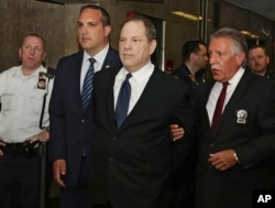 Harvey Weinstein is escorted in handcuffs to a courtroom in New York, July 9, 2018.