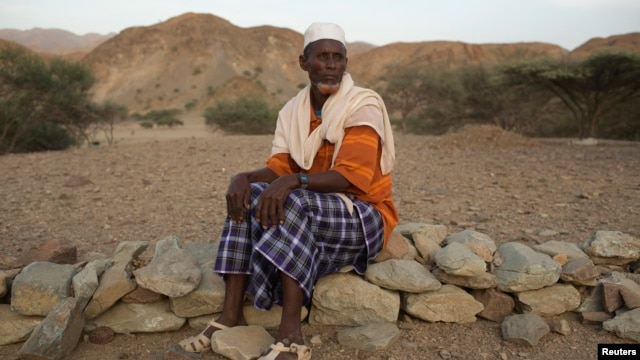 Abdu Ibrahim Mohammed, a retired salt merchant, poses for a photograph close to his home in the town of Berahile in Afar, northern Ethiopia, April 20, 2013.