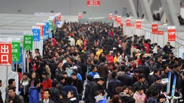 Chinese jobseekers check out the various vacancies offered at a job fair.  Premier Wen Jiabao said China had set a lower than usual economic growth target and pledged to contain soaring prices, February 26, 2011