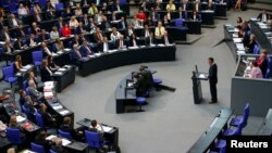 """Cem Oezdemir of the environmental Greens party (Die Gruenen) addresses a session of the Bundestag, lower house of parliament, being held to debate approval of a symbolic resolution that declares the 1915 massacre of Armenians by Ottoman forces a """"genocide"""