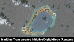 A satellite image shows what CSIS Asia Maritime Transparency Initiative says appears to be anti-aircraft guns and what are likely to be close-in weapons systems (CIWS) on the artificial island Subi Reef in the South China Sea in this image released on Dec. 13, 2016.