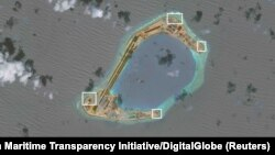 A satellite image shows what the Asia Maritime Transparency Initiative says appear to be anti-aircraft guns and what are likely to be close-in weapons systems (CIWS) on the artificial island Subi Reef in the South China Sea in this image released on Dec. 13, 2016.