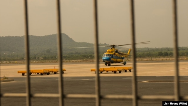 A helicopter takes off Tuesday from Vietnam's southwest Phu Quoc Island to search for the passengers of Malaysian Airlines flight MH370.  (Photo: Lien Hoang for VOA)
