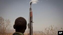 A Sudan People's Liberation Movement rebel soldier looks out toward Talodi, in South Kordofan, a region of Sudan on April 25, 2012.