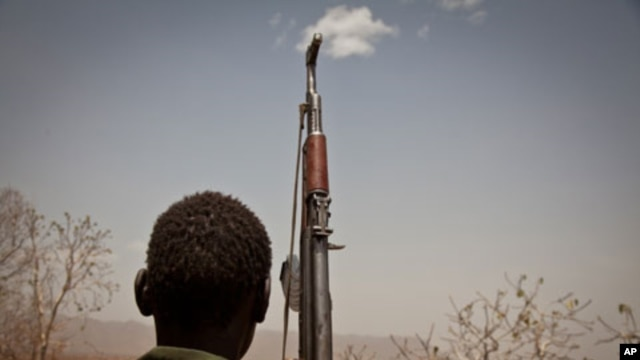 A Sudan People's Liberation Movement (SPLA-N) rebel soldier looks out toward Talodi, in South Kordofan, a region of Sudan, on April 25, 2012