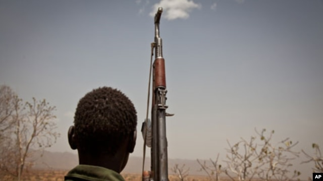 A Sudan People's Liberation Movement  rebel soldier looks out toward Talodi, in South Kordofan, a region of Sudan on April 25, 2012.