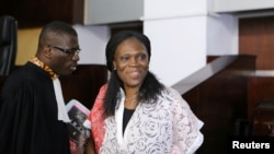 Ivory Coast's former first lady Simone Gbagbo (R), who is accused of crimes against humanity and war crimes for her alleged role in a 2011 civil war, arrives in a domestic court in Abidjan, May 31, 2016.