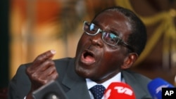 Zimbabwean President Robert Mugabe speaks during a press conference at State House in Harare, July, 30, 2013.