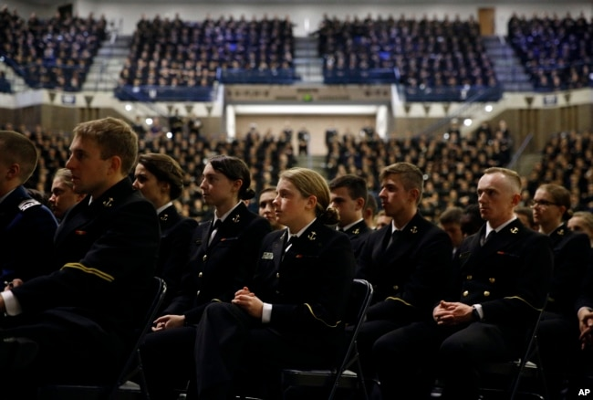 Members of the U.S. Naval Academy listen as Sen. John McCain, R-Ariz., is introduced by former Sen. John Warner, R-Va., at the Academy in Annapolis, Maryland, Oct. 30, 2017.