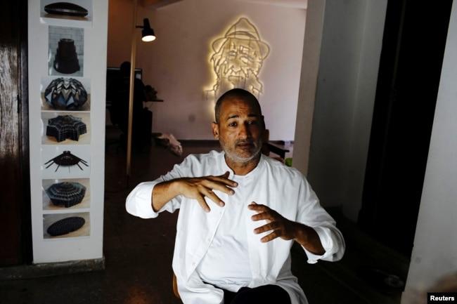 Artist Marco Castillo speaks during an interview at his studio in Havana, Cuba, September 12, 2018. Picture taken on September 12, 2018. REUTERS/Alexandre Meneghini
