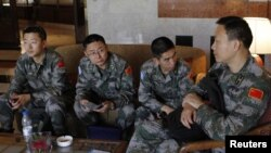 U.N. observers from China at at hotel in Damascus before heading to areas where protests against Syrian President Bashar al-Assad have been taking place, May 18, 2012.