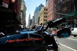 """An electric Harley Davidson motorcycle that is part of the companies """"Project Livewire"""" stands on a street in New York, June 23, 2014."""