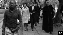 In this June 5, 1966, file photo Sen. Robert F. Kennedy, back right, and his wife, Ethel, back left, arrive at the Roman Catholic Cathedral in Pretoria, South Africa, during a visit to the country. In 1966 Kennedy traveled to apartheid South Africa and spoke about equality and the rule of law. This week members of his family are in democratic South Africa to mark the 50th anniversary of that visit. (AP Photo)