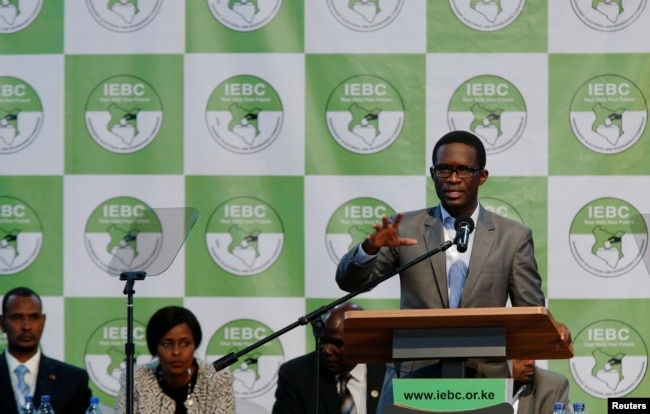 FILE - Chief Electoral Officer of Kenya's Independent Electoral and Boundaries Commission (IEBC) Ezra Chiloba speaks during a news conference ahead of the announcement of the winner of polls in Kenya's election at the Bomas of Kenya, in Nairobi, Kenya, Au