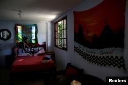 Solange, a worker at Pousada Favelinha (Little favela) hostel, prepares a room in Pereira da Silva favela, in Rio de Janeiro, Brazil, April 21, 2016.