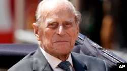 FILE - Britain's Prince Philip is seen sitting in a carriage in London, July 12, 2017.