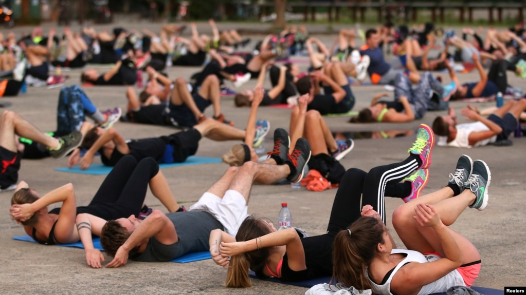Health experts say it is important to stay active. Here, people come together for a public exercise event in Nantes, France, Sept. 2017. (REUTERS/Stephane Mahe)