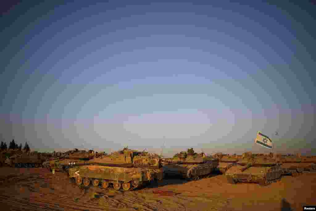 Israeli tanks are waiting for orders in a staging area near the border with the Gaza Strip, Aug. 7, 2014.